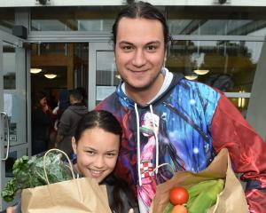 Paikea Hunter (11) and big brother Ammon stock up on produce after getting a blood ...