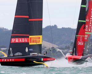 Luna Rossa Prada Pirelli in action with Emirates Team New Zealand during Race 2 of the America's...