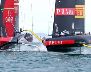 Team NZ's yacht Te Rehutai (left) and Luna Rossa on Auckland's Waitemata Harbour. Photo: Reuters