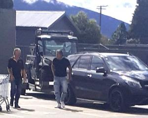 Destiny Church leader Brian Tamaki (right) in a supermarket car park in Te Anau on Tuesday. PHOTO...