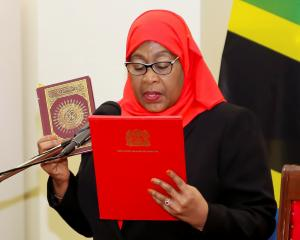 President Samia Suluhu Hassan takes the oath of office at State House in Dar es Salaam after the...
