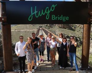 Raising their glasses to the Hugo Bridge are (from left) Scotty Blythen (Hugo friend), Kayleigh...
