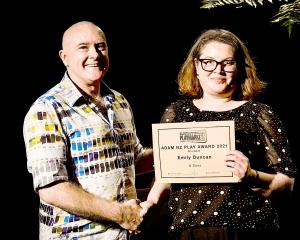 Playmarket director Murray Lynch presents Emily Duncan with her latest playwriting award — the...