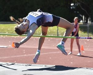 Emelia Adamson, of Otago Girls' High School, comfortably clears the bar at the Caledonian Ground...