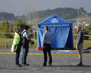 A blue forensic tent was erected over the car last night. Photo: NZ Herald