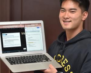 Showing his distance learning programme on a laptop at Cumberland College is University of Otago...