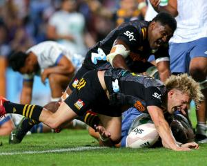 An elated Damian McKenzie after scoring the winning try for the Chiefs. Photo: Getty Images
