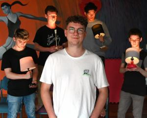 Director Harrison Kennedy is surrounded by (from left) Conor Hill (19), Christian Tucker (22),...