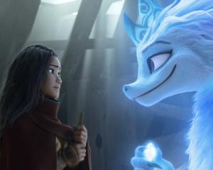 Raya, voiced by Kelly Marie Tran, and Sisu, voiced by Awkwafina, in the movie Raya and the Last...