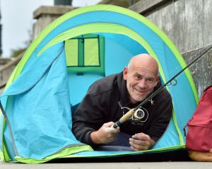 Fisherman Daniel Scorringe, of Dunedin, pitched his tent beside Otago Harbour yesterday morning...