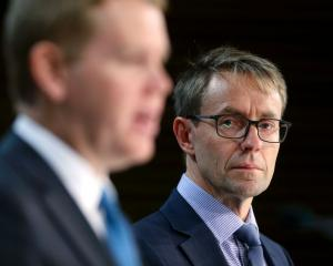 Chris Hipkins (left) and Dr Ashley Bloomfield. Photo: Getty Images