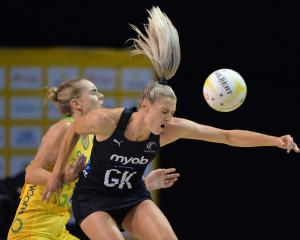 Jane Watson competes with Kiera Austin for the ball as the Silver Ferns face Australia in...