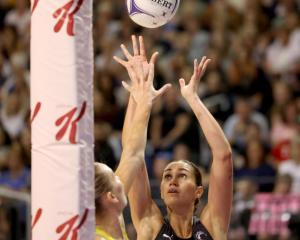 Silver Ferns captain Ameliaranne Ekenasio shoots while under pressure from 
