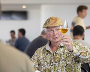 Grenville Caughey  judges a beer at the New World Beer & Cider Awards in Christchurch last...