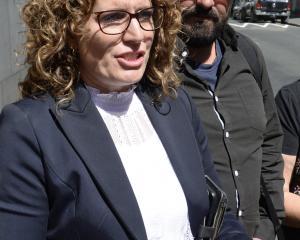 Lia Bezett, sister of murder victim Brent Bacon, and her husband Sam Bezett, outside the Dunedin...
