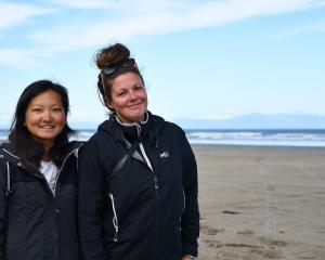 French travellers Caroline Ly and Oaianne Lelay visited an Invercargill beach yesterday morning,...