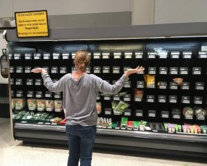A shopper inspects the bagged salad range at Pak'nSave in South Dunedin on Monday night. PHOTO:...