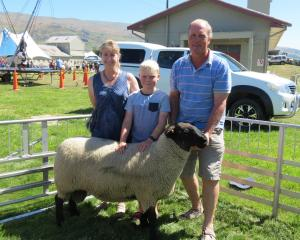 Ross and Tracey McCall, along with son Flynn, were delighted to win supreme sheep at the Mt...