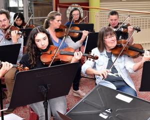 """Members'' of Strork rehearse for their Fringe Festival concert. PHOTO: GREGOR RICHARDSON"