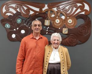Greg Houkamau and his mother, Angela Houkamau, in front of the completed carving. PHOTO: TRACEY...