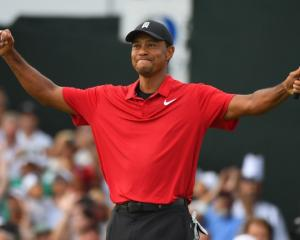 Tiger Woods reacts to win the Tour Championship. Photo: Christopher Hanewinckel-USA TODAY Sports