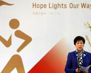 Tokyo's governor Yuriko Koike at the Grand Start of the Olympic Torch Relay in Naraha, Fukushima...
