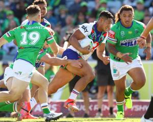 Warriors skipper Roger Tuivasa-Sheck makes a break against the Raiders in Canberra on Saturday....