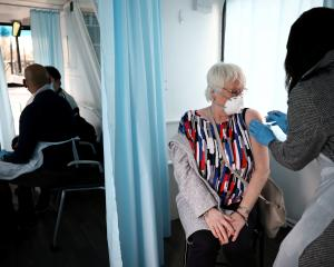 A woman receives a dose of the Oxford-AstraZeneca vaccine in Thamesmead, London. Photo: Reuters