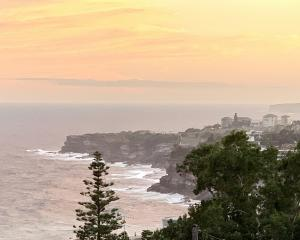 Sunset from the balcony at David and Imy's Love Home Swap apartment near Bondi, Sydney. Photos:...