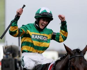Rachael Blackmore celebrates her victory in the Grand National. Photo: Reuters