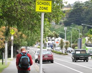 Electronic variable speed limit signs, like this one outside Kaikorai Valley College, are...