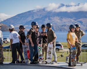 Young skaters stand by during Wanaka Festival of Colour's Cross the Line street performance at...
