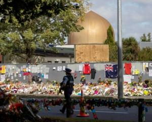 Flowers at the gate of the Al Noor Mosque in Christchurch. Photo: NZME