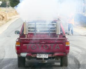 The 4-litre Toyota ''Hoelux'', driven by Jenna Cunningham, of Waitahuna, smokes it up before the...