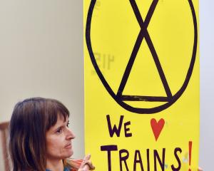 Environmentalist Jennifer Shulzitski shows her support for Dunedin's train service. PHOTOS: PETER...