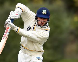Otago batsman Max Chu watches the ball off his bat during the first innings of his side's Plunket...