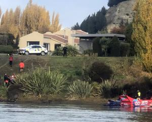 Wanaka Search and Rescue Swift Water team members and police retrieve the body of a man from the...