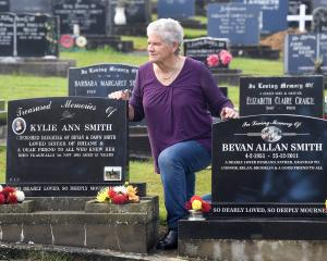Dawn Smith was brightening up the graves of her daughter Kylie and husband Bevan at the Owaka...