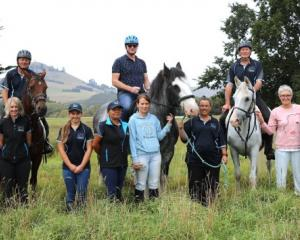 In the saddle ... Waitaki Mayor Gary Kircher (centre on horse) enjoys a day out with the Waitaki...