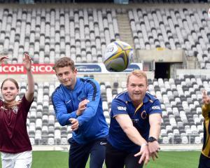Dunedin Technical football player Rose Connor (8), Football South Development Officer Alex Cox,...