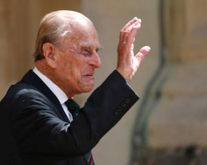 Prince Philip waves as he takes part in the transfer of the Colonel-in-Chief of The Rifles at...