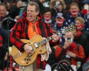 Ted Nugent performs The Star Spangled Banner during a campaign rally for Donald Trump in Lansing,...
