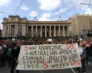 Supporters of the indigenous community gather in front of Parliament House in Melbourne. The...