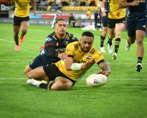 Ngani Laumape gets away from an Aaron Smith tackle to score for the Hurricanes. Photo:  Getty...