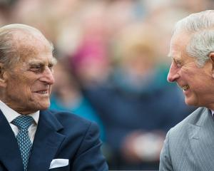 Prince Philip and Prince Charles together during a visit to Poundbury, Dorset, in 2016. Photo:...