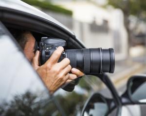 A generic image of a private investigator in a car. Photo: Getty