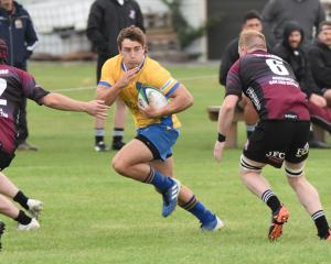 Josh McKay eyes a gap against Ohoka during his senior rugby debut for Kaiapoi. Photo: Shane...