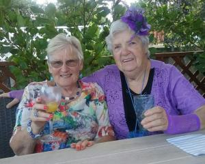 Shirley Smith (Shirley No 68), left, and another Shirley in the club's colours of purple and aqua...