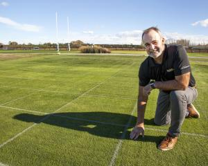 Turf expert Mark Shaw gets down to earth with a grid pattern of grasses at PGG Wrightson Seeds...