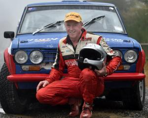 Otago Rally competitor John Spencer gets in a practice drive in his Datsun at Whare Flat...